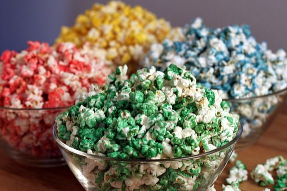 This is an easy way to make delicious, sweet colored popcorn. Just add your choice of food coloring to make it any color in the rainbow. This is a fun snack to make in holiday, team or school colors.