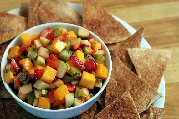 This is a fun, sweet & tangy twist on traditional spicy salsa and chips. It's versatile and can be served as an appetizer, with breakfast or brunch, and as a healthy dessert option.
