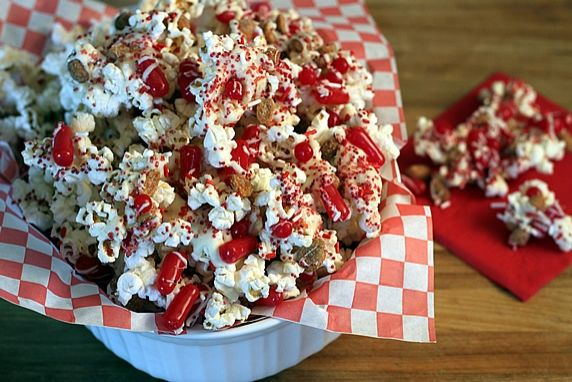 This easy, delicious, festive party mix is perfect to serve for RED HOT sports teams (like the St. Louis Cardinals!), for your RED HOT love on an anniversary or Valentine's Day, or, it can be a Firecracker Popcorn Party Mix for the 4th of July or other celebration.