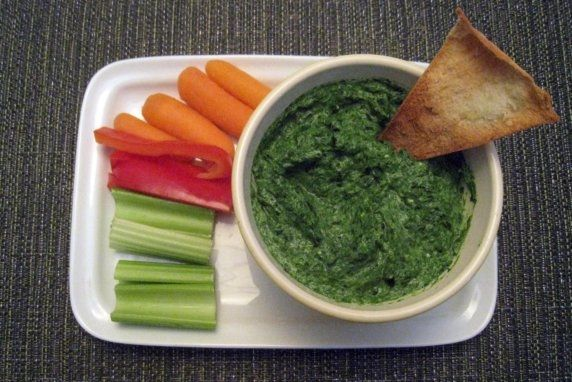 This spinach dip is a healthy, fresh, and delicious alternative to other spinach dips. The fresh basil really brightens the dip, while the yogurt, light cream cheese, and Parmesan add just enough creaminess.