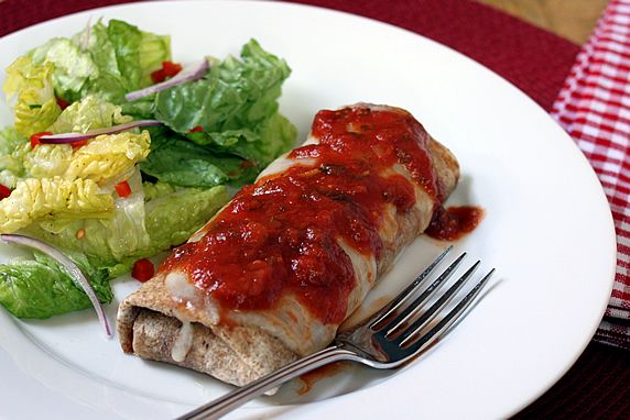 A fun, easy recipe for Italian Chicken Parmesan wrapped up like a Mexican burrito. A whole grain tortilla, lean chicken, & spinach make it a healthy choice.