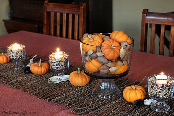 DIY Fall candles and centerpieces using inexpensive, everyday items that you can find at the grocery store. Great project for kids, too.