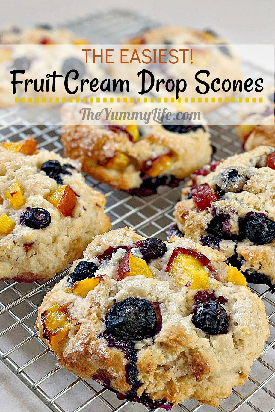 These tender scones are so easy! Mix batter, drop in mounds onto baking sheet, bake, and enjoy. Use fruit of your choice. Make-ahead convenience and freezable. From TheYummyLife.com #scones #creamscones #dropscones #fruitscones #easy #makeahead #freezable