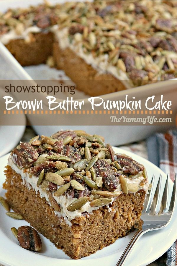 BEST. CAKE. EVER. Browned butter in the cake and cream cheese frosting and a sweet and salty nut topping make this a showstopper. A great addition to your Thanksgiving desserts. From TheYummyLife.com #pumpkin #pumpkin spice #cake #brown butter #pepitas #pecans #Thanksgiving dessert #cream cheese frosting