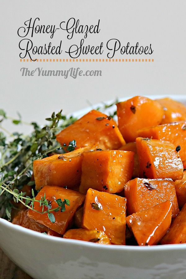 A honey glaze caramelizes and coats the sweet potatoes to elevate their natural flavor. An easy, tasty recipe for this super nutritious vegetable. From TheYummyLife.com #sweetpotatoes #honey #thyme #ovenroasted #easy #Thanksgiving #nutritious