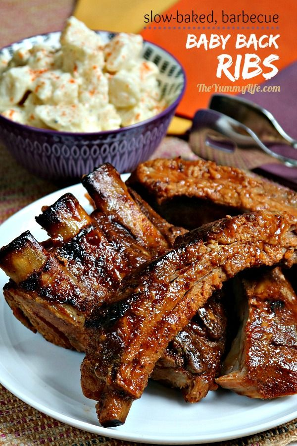 These easy, slow-baked ribs are seasoned with dry rub and barbecue sauce. They are  tender, flavorful, and finger-lickin' good! Finish these off by browning for just a few minutes on the grill or under the oven broiler. Make-ahead convenience. From TheYummyLife.com #babybackribs #barbecue #BBQ #picnicfood #cookout #grill #makeahead #4thofJuly #MemorialDay #LaborDay