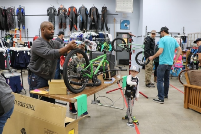 Bay Area Bike Project staff building bikes for children