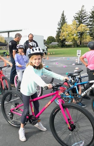 Girl on a bike at a Bay Area Bike Project event