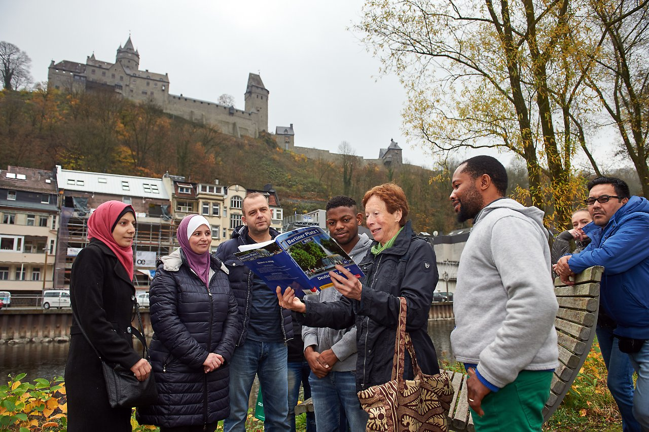 Migrants and a volunteer from Altena's Kümmerer programme