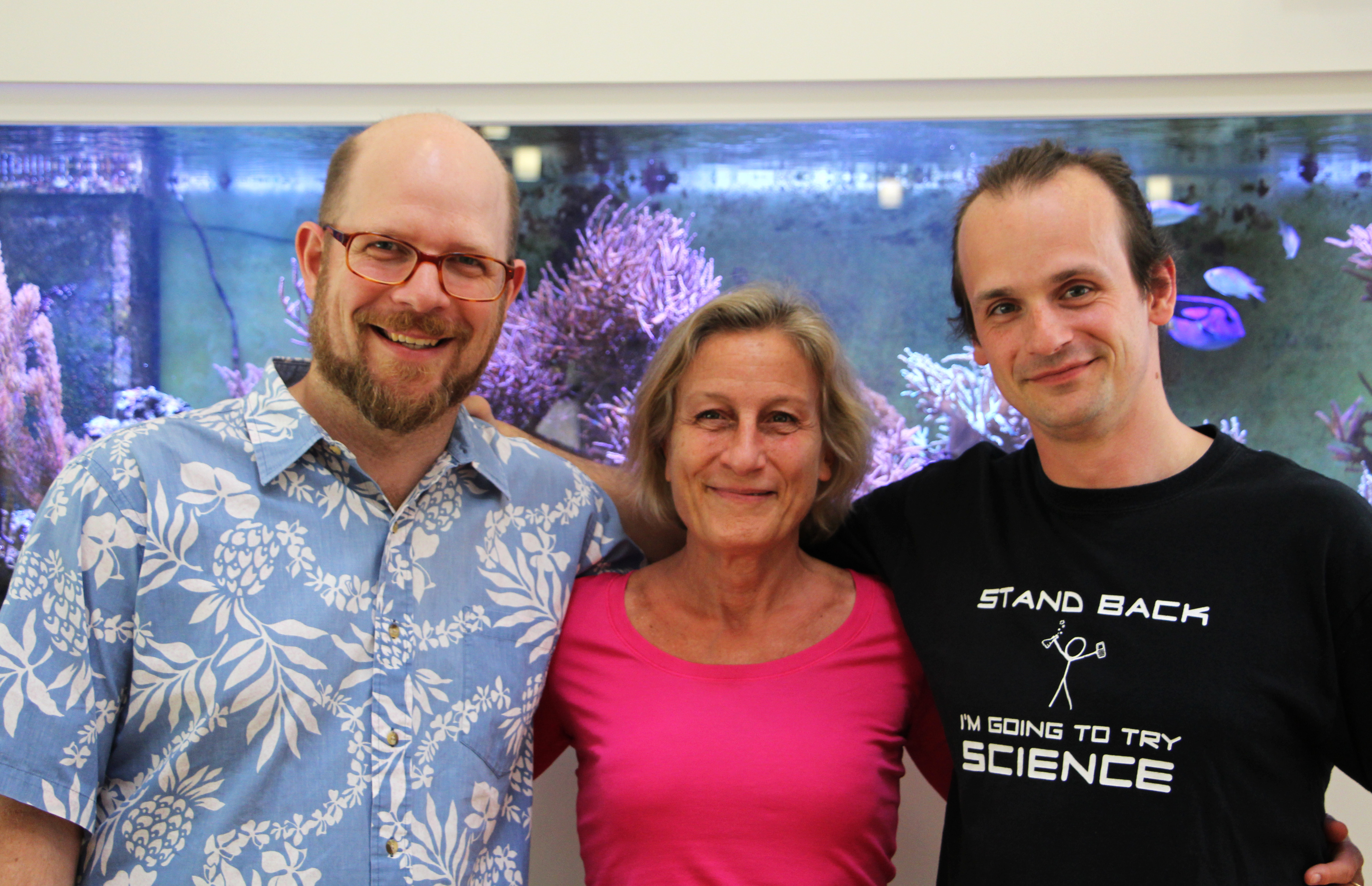 The lead authors and the PI in front of a treasure hidden in plain sight - an aquarium full of Trichoplax
