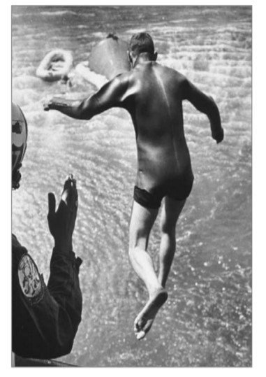 Carpentier practicing for recovery of astronauts from a water landing.