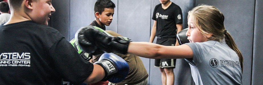 children and youths learning MMA at Systems Training Center