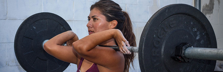woman practicing CrossFit holding a front squat