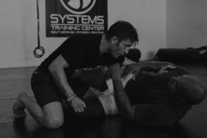 coach and student training together jiu-jitsu