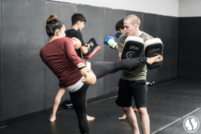 Systems Training Center personal trainer teaches kickboxing