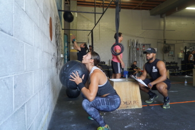 Personal trainer teaching member in group fitness class at Systems Training Center