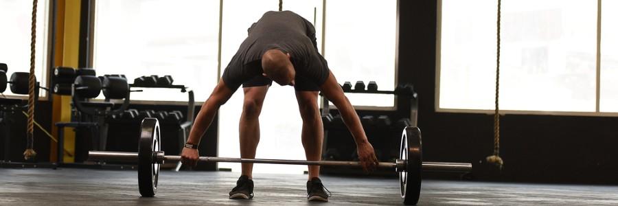 man deadlifting in a gym