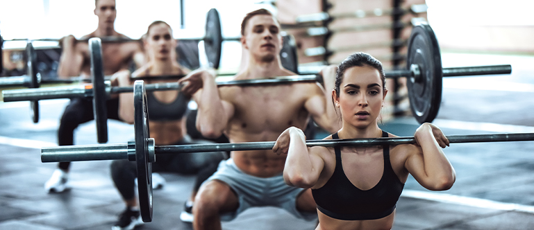 Athletes in CrossFit class performing squats