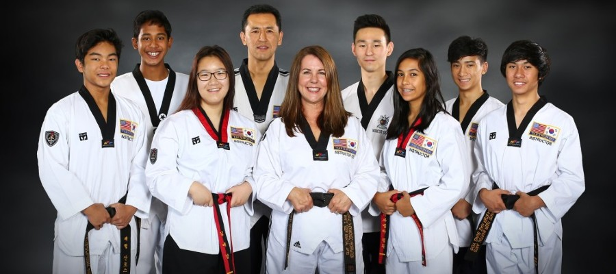 Owners, Instructors and top Taekwondo students smiling for picture in Mill Creek