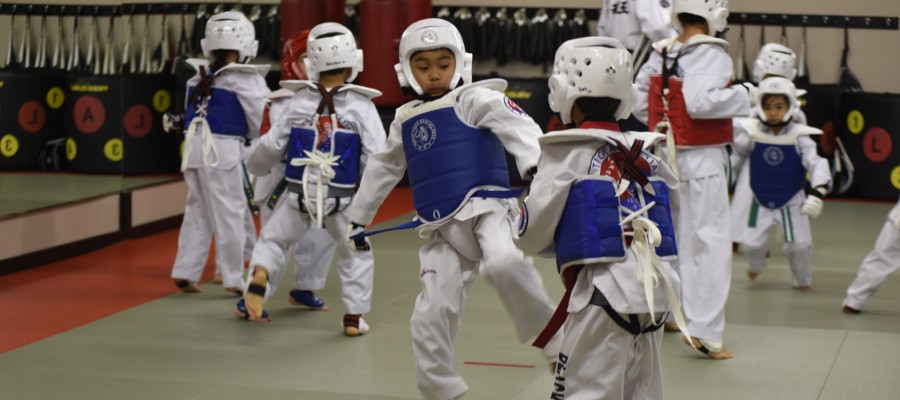 Young students practicing in sparring equipment