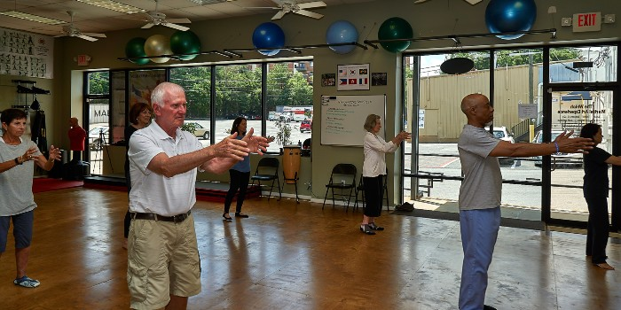 group of seniors practicing tai chi