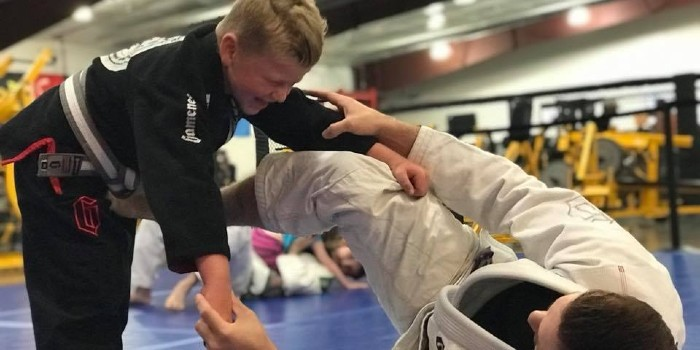 child practicing jiu jitsu skills