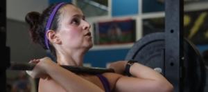 woman in beginner class lifting weight