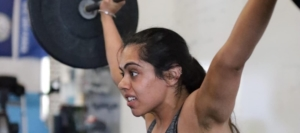 woman lifting heavy weight above her head