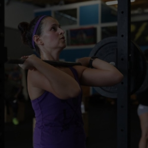 woman in beginner class lifting weight