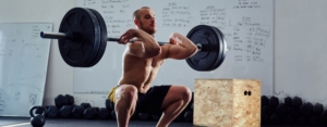 man lifting heavy weight in crossfit class