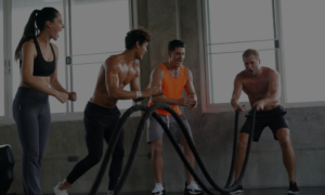 group of students cheering for students in crossfit class