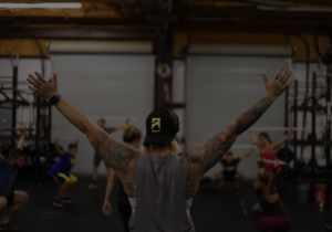 woman with arms in the air in fitness class