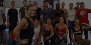 woman smiling in front of fitness class