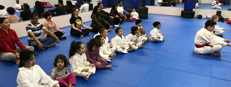parents sitting with children at child taekwondo class in Springfield, NJ