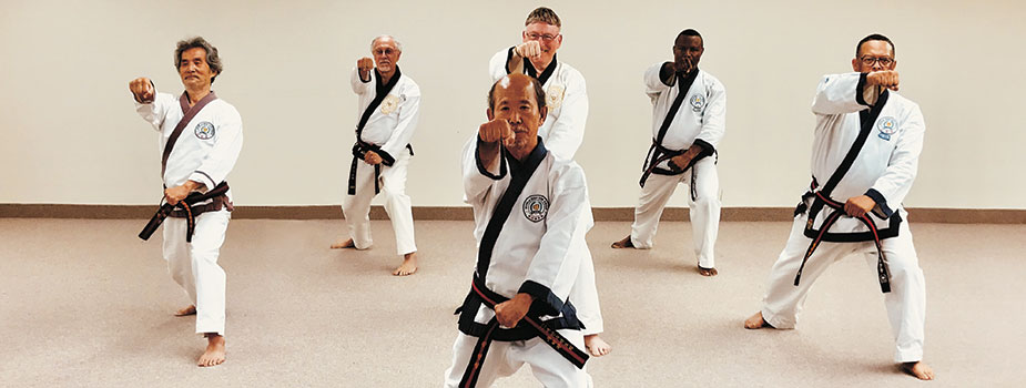 Moo Duk Kwan instructors demonstrating karate technique
