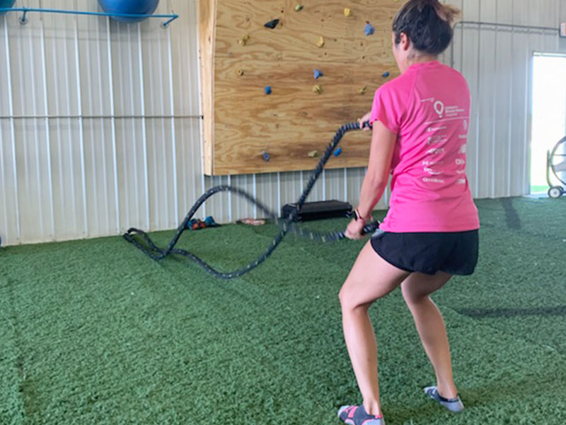 Athlete using battle ropes