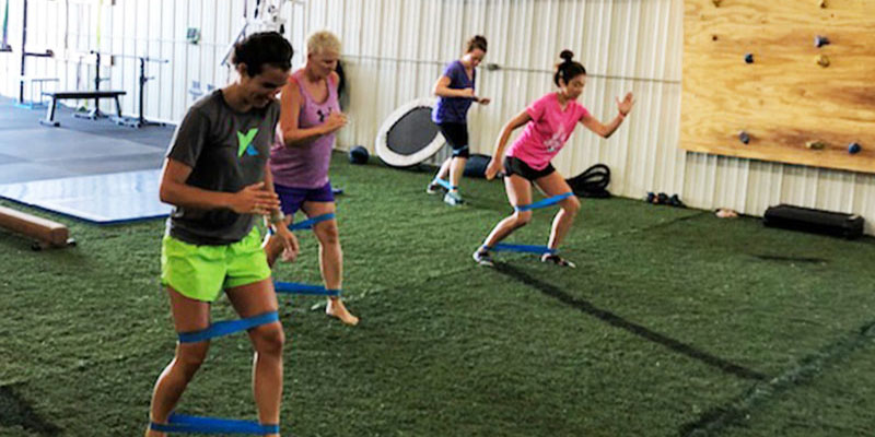 Group using resistance bands for training