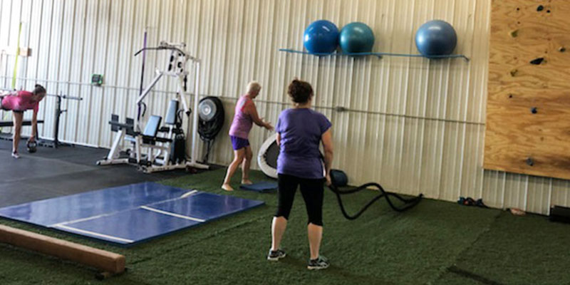 Female athletes training in gym