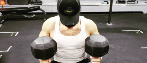 Athlete training with dumbells