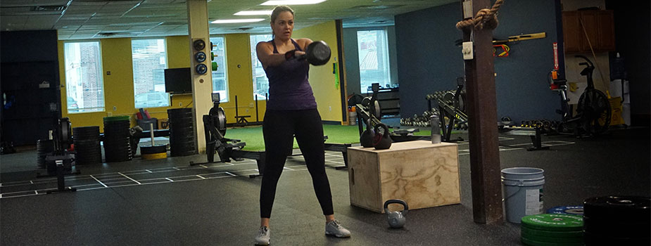 Rose holding a kettle bell.