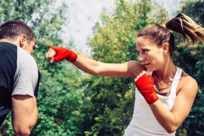 woman sparring with man