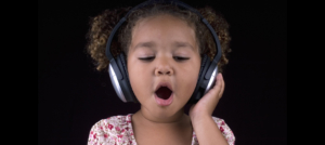 girl singing with headphones