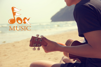 Teen playing Ukulele on beach