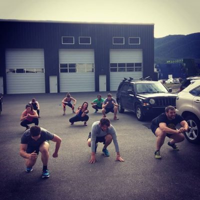 people working out in parking lot outside Tongass Fitness