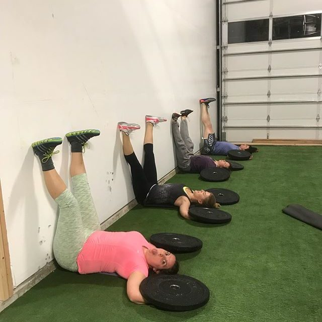 gym members stretching on artificial turf