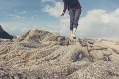 Barefoot training woman on rocks