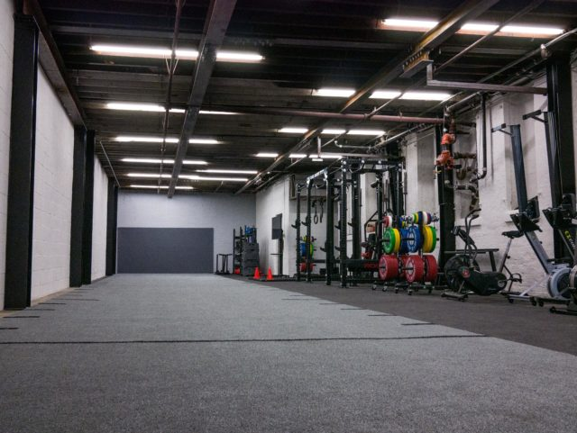 squat racks, pullup bars, and floor space inside SBWC