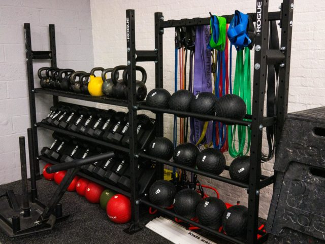 rack of kettlebells and medicine balls in SBWC