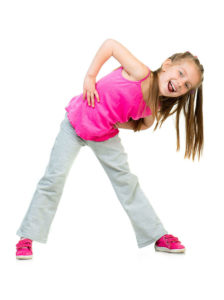 a girl stecthing or doing a pose