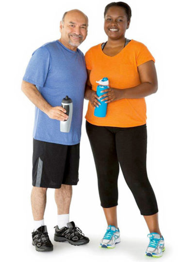 adults taking a picture while holding water bottles